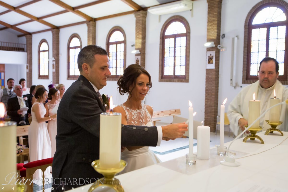 Lighting-candles-in-Church-1