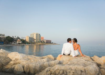 Bride and Groom on Rocks by Luna