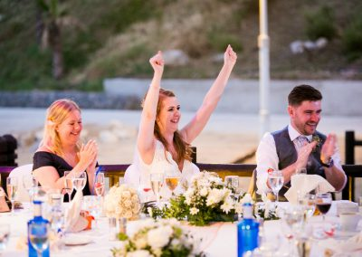 Bride cheering during speeches