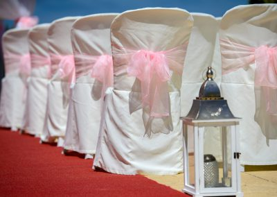 Chair covers with pink ribbons