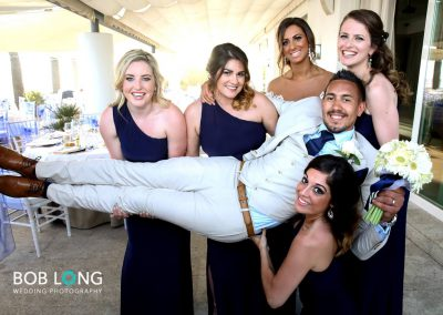 Groom with bride and bridesmaids