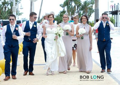 Bridal party walking to drinks reception