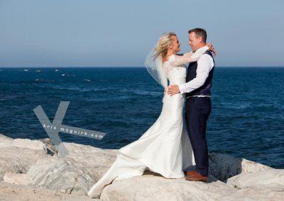 Brid and groom by the ocean