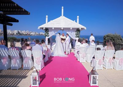 Ceremony on the seafront promenade with pink carpet