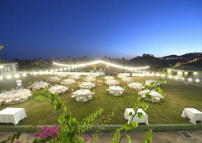 Wedding breakfast tables on grass terrace